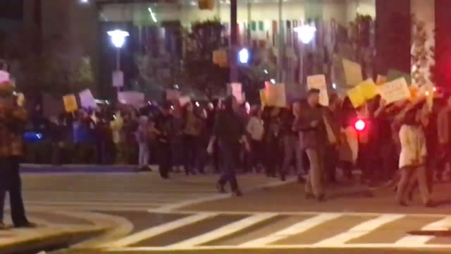 footage of antitrump protestors on pratt st in front of the world trade center in downtown baltimore - baltimore stock-videos und b-roll-filmmaterial