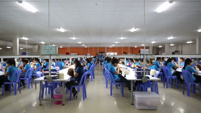 Footage of Artnature and Laurelton Diamonds Factories in Phnom Penh Cambodia on June 6 2015 Shots CU of worker blending hair on many sharp objects...