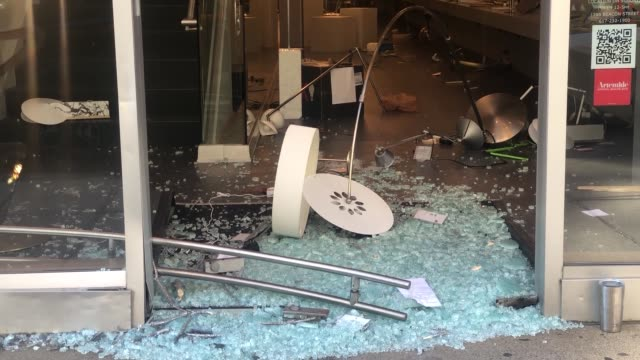 footage of back bay businesses with smashed windows and cleanup following the riots on 5/31/20 - back bay stock-videos und b-roll-filmmaterial