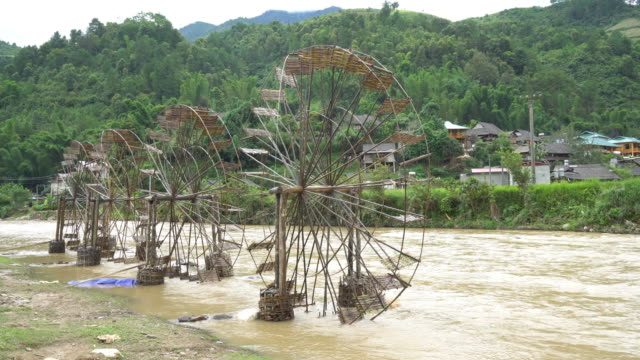 footage of bamboo water wheel for hydraulic turbine in traditional style,4k clip - water wheel stock videos and b-roll footage