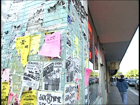footage of band fliers on side of building - audio software stock videos & royalty-free footage
