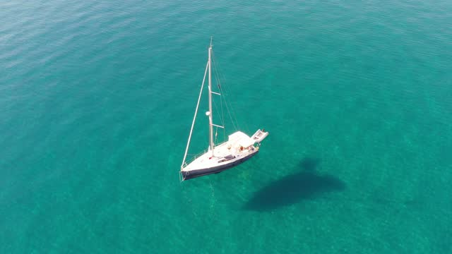 4k footage of beautiful transparent sea and sailboat in antalya city with by drone - bay of water stock videos & royalty-free footage
