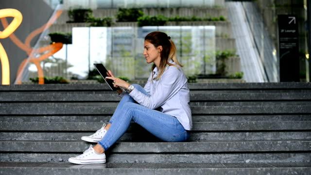 footage of beautiful woman using digital tablet - lypsekyo16 stock videos and b-roll footage