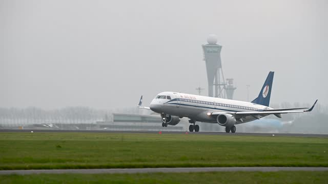 footage of belavia embraer jet taking off on cloudy day - editorial stock videos & royalty-free footage