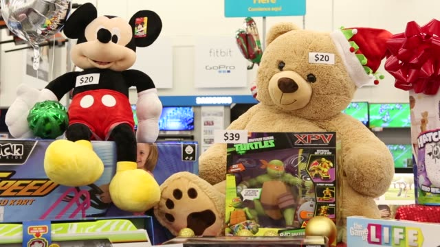 Footage of Black Friday displays and items at a WalMart Stores Inc location in Burbank California US on Tuesday Nov 22 Shots pan right of TVs and...