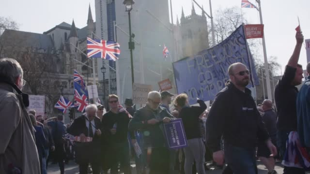 Footage of Brexit demonstrators in Parliament Square Westminster London during the March to Leave protest