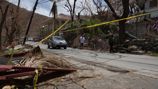 footage of cars passing in road by hurricane debris and wreckage in st john us virgin islands on september 12 2017 photographer michael nagle shots... - st. john virgin islands stock videos & royalty-free footage