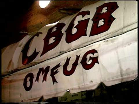 footage of cbgb's sign and crowd waiting to get in - leather jacket stock videos and b-roll footage