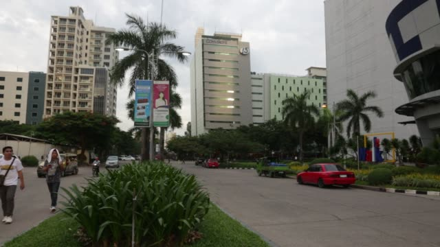 Footage of Cebu IT Park in Cebu City Philippines on August 1 2015 Shots wide shot of sky rise buildings standing in Cebu City pan right past same...