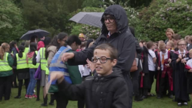 footage of children dressed as harry potter having their outfits checked to make sure they comply with the criteria to set a new guinness world... - harry potter titolo d'opera famosa video stock e b–roll