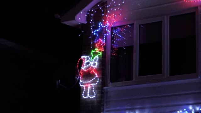 footage of christmas lights on stone brig lane, leeds. the street in the suburb of rothwell puts on a display every year and is asking for donations... - エルフ点の映像素材/bロール