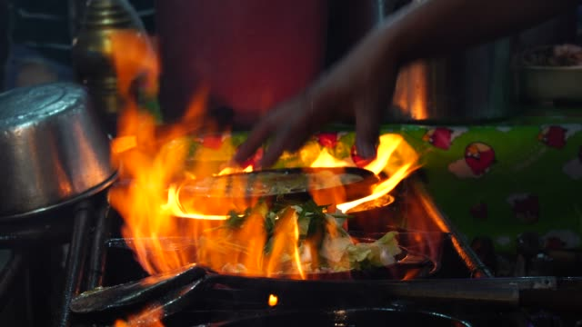 4K footage of closeup cooking Suki stir-fried by spade of frying pan over pan, Thailand tradition food, asian food