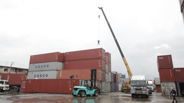 stockvideo's en b-roll-footage met footage of containers being moved at a depot of sv depot co ltd in bang na a suburb of bangkok on october 13 2015 shots wide shot of shipping... - toyota motor