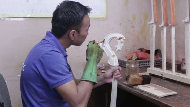 footage of craftsmen making morin khuur at a khanmusic llc shop in ulaanbaatar mongolia on august 11 2017 photographer taylor weidman shots wide shot... - paint horse stock videos & royalty-free footage