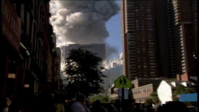 footage of crowds of people watching the aftermath of one of the world trade center towers collapse and running away from the massive cloud of dust... - 2001 stock videos & royalty-free footage