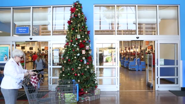 stockvideo's en b-roll-footage met footage of customers shopping at a walmart stores inc location in burbank california us on tuesday nov 22 shots wide view of entertainment section as... - wal mart