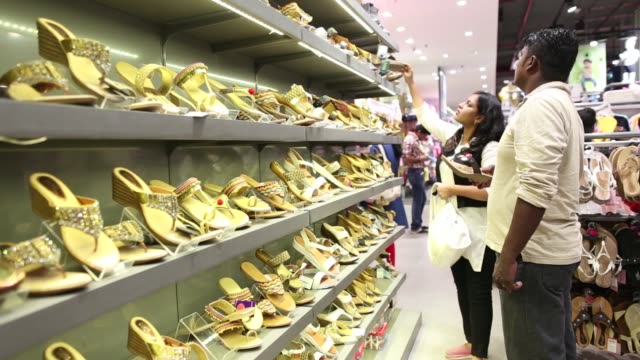 Footage of customers shopping for clothing and apparel in Big Bazaar and FBB in a mall in Mumbai India on April 17 2017 Shots wide shot of clothing...