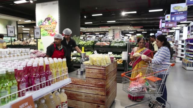 Footage of customers shopping for food and other products in a Big Bazaar and FBB in a mall in Mumbai India on April 17 2017 Shots wide shot of...