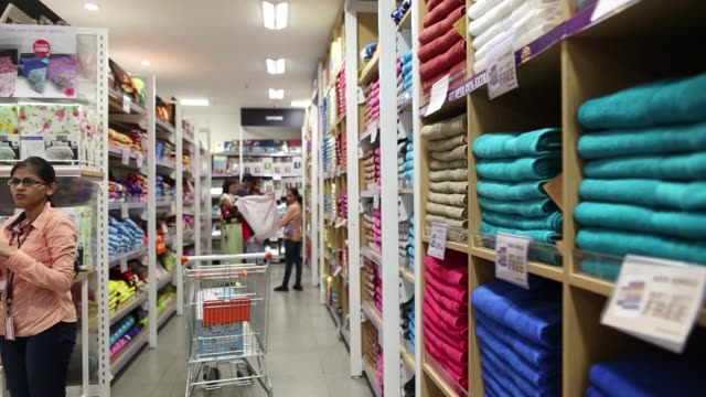 Footage of customers shopping for housewares in Big Bazaar and FBB in a mall in Mumbai India on April 17 2017 Shots shot of two people shopping for...