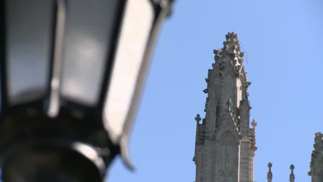 footage of damage to the national cathedral showing damage to pinnacles a crack in a buttress and some debris on the ground the building is sealed... - building feature stock videos & royalty-free footage