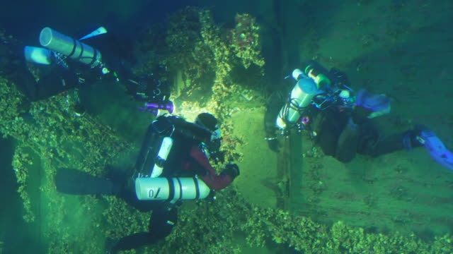 Footage of deep sea divers inspecting the sunken Britannic the sister ship of the Titanic in Greece NNPW683X