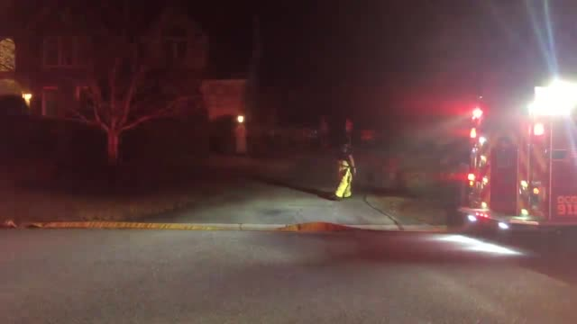 Footage of firefighters fighting a fire on Fairway Woods Drive The fire started in the garage No one was injured