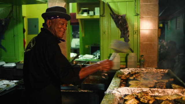 footage of fish being cooked at oistins fish fry in barbados - bbq stock videos & royalty-free footage