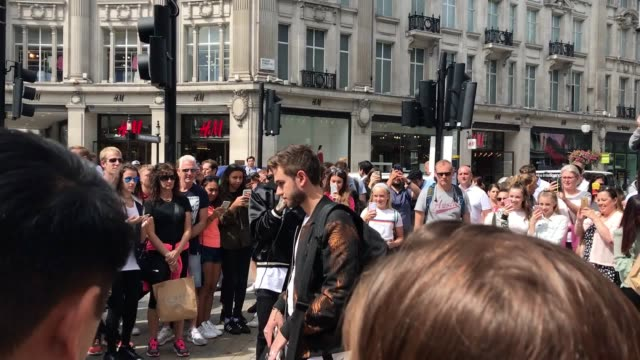 footage of former one direction star liam payne busking on oxford street london - liam payne stock videos and b-roll footage