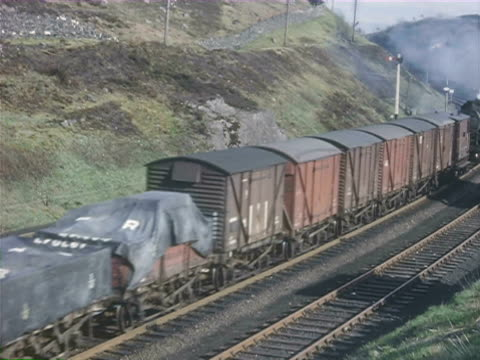 ws footage of freight steam train going across countryside / shap, cumbria, england - western script stock videos & royalty-free footage