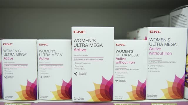footage of gnc brands and vitamins on display at a midtown manhattan gnc store on october 26 2017 photographer mark kauzlarich shots cu of women's... - vitamin stock videos & royalty-free footage