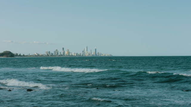 4K footage of Gold Coast from Burleigh Heads, with the sea in front and the city of Gold Coast at the background in slow motion