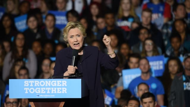 Footage of Hillary Clinton campaigning as well as Trump supporters in Columbus Ohio on October 10 2016 ShotsWide shot from side of Hillary speaking...