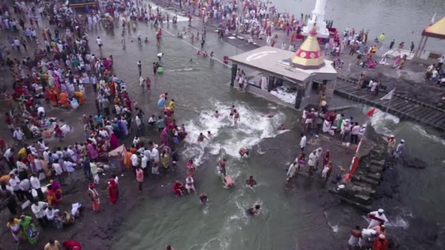 Footage of Hindu pilgrims bathing in the Godavari river in Nashik Maharashtra India on Friday Sept 11 2015 Shots large wide shot of many people...