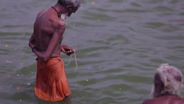 Footage of Hindu pilgrims bathing in the Godavari river in Nashik Maharashtra India on Friday Sept 11 2015 Shots Footage of people bathing in the...