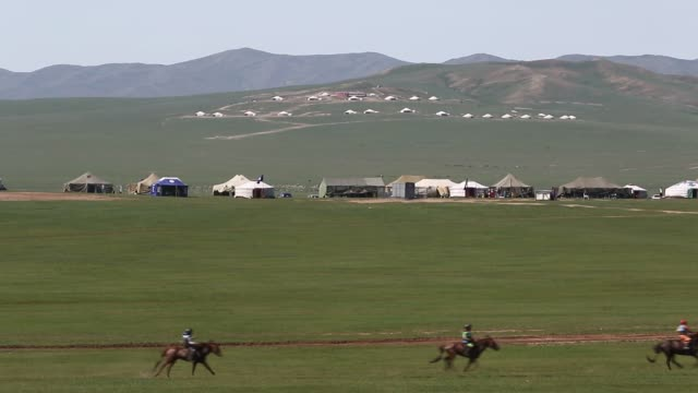 footage of horse racing and cattle market in emeelt uul outskirts of ulaanbaatar mongolia on saturday aug 8 2015 shots wide shto of huge field with... - independent mongolia stock videos & royalty-free footage