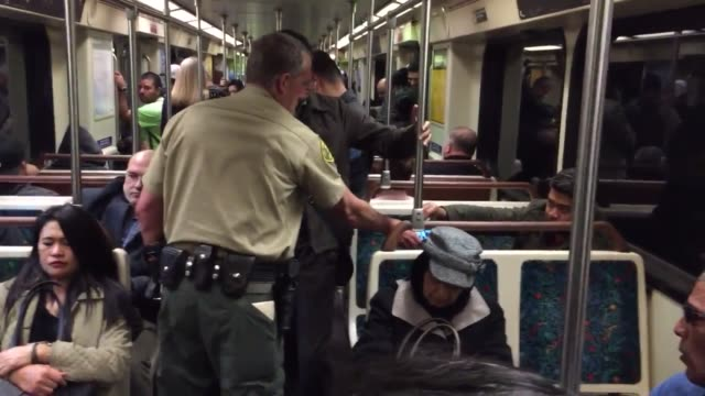 footage of increased security at the metro universal city red line station that is the result of a tip about a possible bombing of the station. - universal city video stock e b–roll