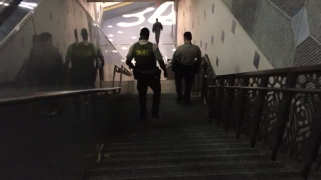 footage of increased security at the metro universal city red line station that is the result of a tip about a possible bombing of the station - universal city video stock e b–roll