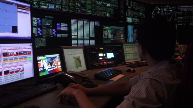 vídeos y material grabado en eventos de stock de footage of inside of the television studio control room and sattelite dishes in astro malaysia holdings bhd's home shopping channel at the... - estudio de televisión