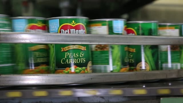 Footage of labeled cans at a Del Monte Foods Inc plant in Mendota Illinois US on Friday June 23 2017 Shots Close ups of many cans moving past frame...