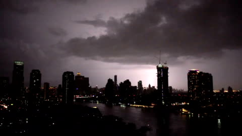 fhd footage of lightning with thunderstorm clouds at night over the bangkok cityscape river side, thailand - lightning stock videos & royalty-free footage