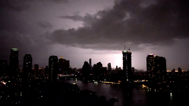 fhd footage of lightning with thunderstorm clouds at night over the bangkok cityscape river side, thailand - temporale video stock e b–roll