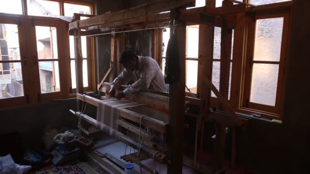 footage of looms being used to make pashmina related clothing at a home workshop in srinigar jammu and kashmir india on monday aug 24 2015 shots cu... - shawl stock videos & royalty-free footage