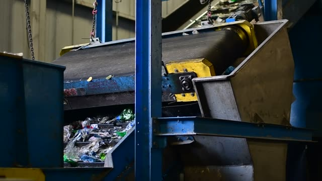 footage of machines processing bottles and plastic at the blue mountain plastic recycling facility in shelburne canada on february 9 2017 shots wide... - mid distance stock videos & royalty-free footage