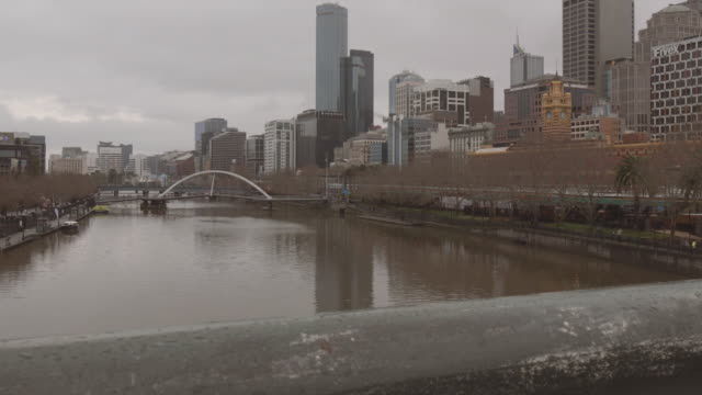 4K footage of Melbourne skyline and Yarra River from Princess Bridge