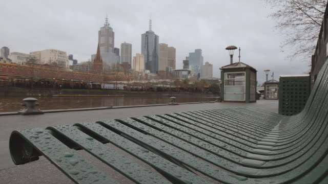 4k footage of melbourne skyline, the river from a bench in a winter day - overcast stock videos & royalty-free footage