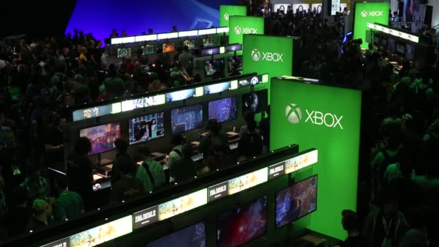 footage of microsofts xbox and video games as attendees of e3 play at the los angeles convention center in los angeles ca on june 15 2016 shots shot... - xbox stock videos & royalty-free footage