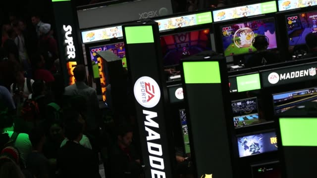 stockvideo's en b-roll-footage met footage of microsoft's xbox demo kiosks as attendees play video games during the electronic entertainment expo at the los angeles convention center... - los angeles convention center