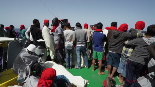 footage of migrants aboard a rescue ship on their way to italy - crisis stock videos & royalty-free footage