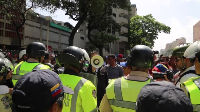 Footage of National Police anti riot forces during protests in Caracas Venezuela on Saturday April 4 2017 Shots wide shot of riot police next to...