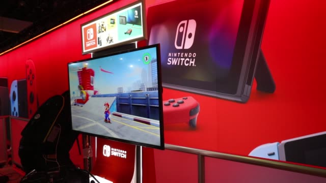 footage of nintendo booth and gamers playing the nintendo switch during the electronic entertainment expo at the los angeles convention center in los... - television game show stock videos & royalty-free footage
